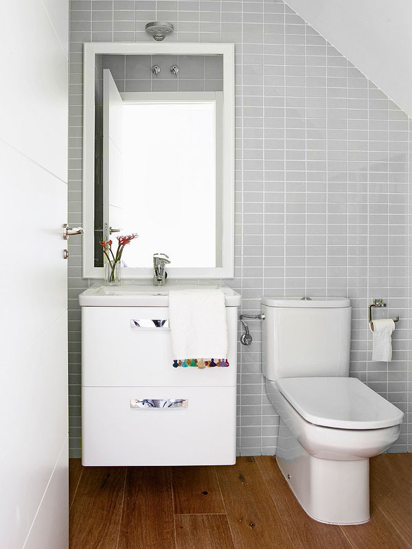 attick-bathroom-white-cabinets-light-grey-tiles-wood-bathroom-floor
