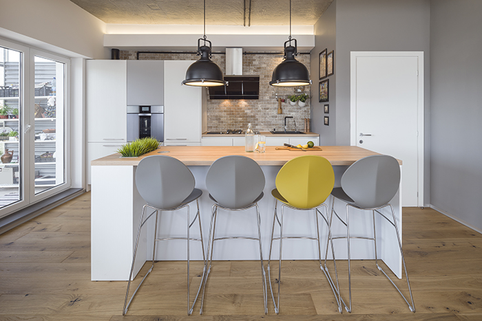 grey-and-yellow-kitchen-chair-industrial-lighting-expose-brick-wall