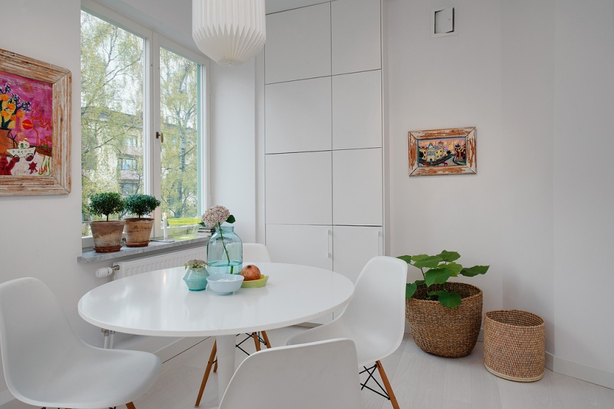 scandinavian apartment dining table white eames chair