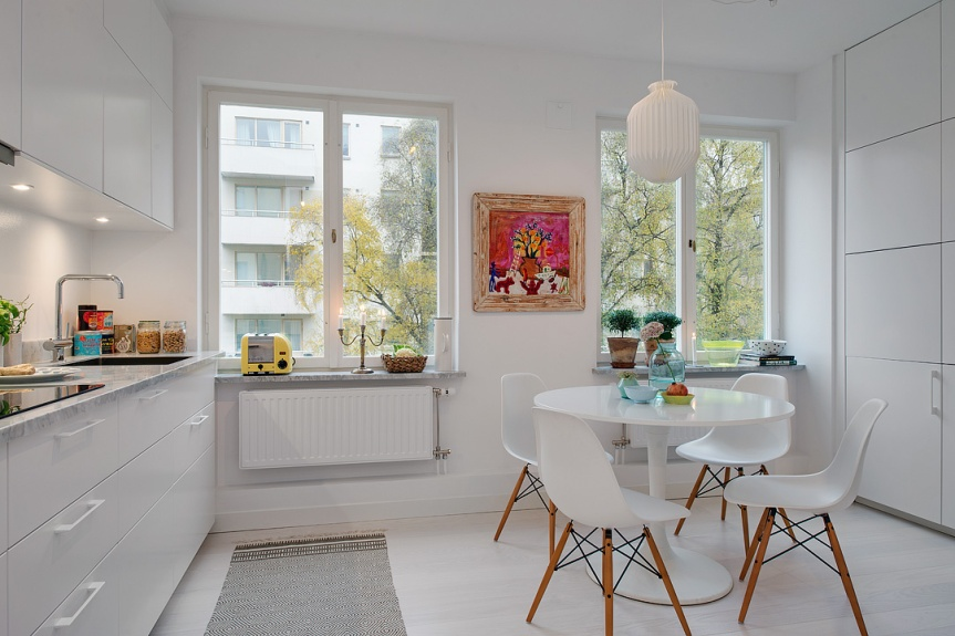 scandinavian apartment kitchen dining table white eames chair