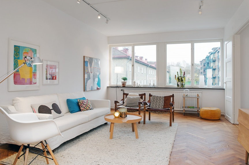 scandinavian apartment living room white eames daw chair