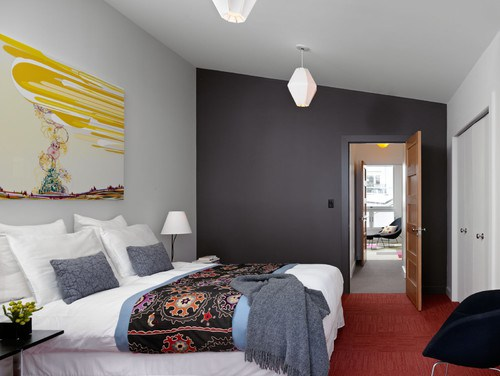 contemporary-bedroom-grey-wall-yellow-painting