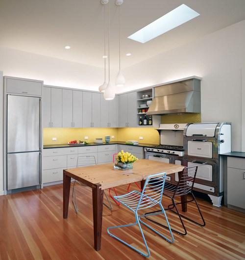 contemporary-white-kitchen-yellow-blacksplash-wood-dining-table