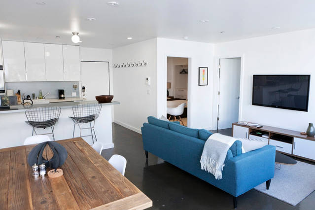 open_space_kitchen_dining_living_room_blue_sofa_