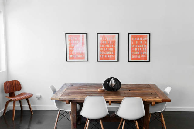 reclaim_wood_dinind_table_white_eames_chair_wall_paintings